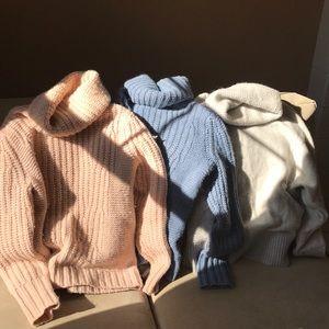 Three small banana republic sweaters.